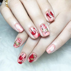 方圆形红色粉色金色手绘圣诞蝴蝶结美甲图片