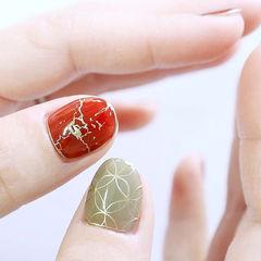 圆形红色绿色金色手绘美甲图片