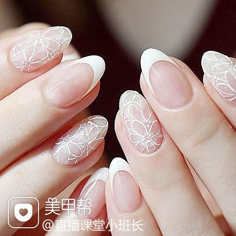 圆形白色法式手绘花朵简约新娘美甲图片