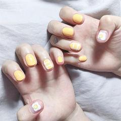 圆形黄色白色手绘鸡蛋短指甲美甲图片