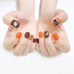 圆形棕色橙色手绘可爱磨砂美甲图片