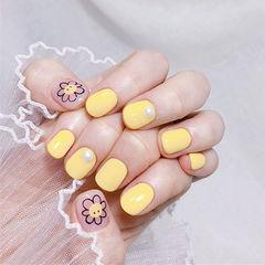 圆形黄色花朵可爱珍珠短指甲学生美甲图片