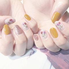 圆形黄色银色手绘花朵想学习这么好看的美甲吗?可以咨询微信mjbyxs6哦~美甲图片