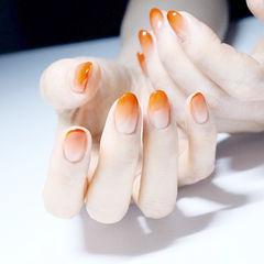 圆形橙色渐变秋天显白美甲图片