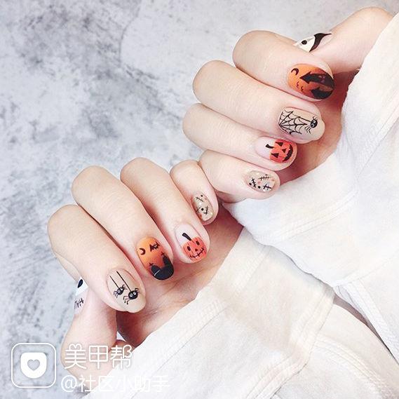 圆形橙色黑色渐变手绘万圣节磨砂美甲图片