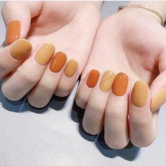 圆形橙色黄色跳色美甲图片