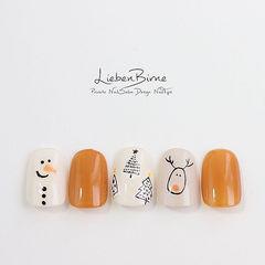 圆形橙色裸色手绘可爱圣诞美甲图片