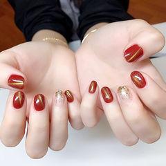 圆形红色金色渐变猫眼新年显白美甲图片