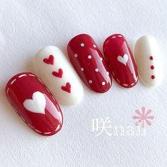 圆形红色白色手绘心形波点新年美甲图片