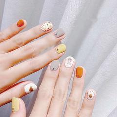 圆形橙色灰色白色手绘兔子可爱短指甲跳色美甲图片