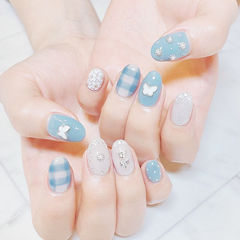 圆形蓝色白色手绘格纹饰品全国连锁日式学校学美甲加微信:mjbyxs15美甲图片