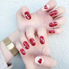 圆形红色白色手绘心形心跳新年美甲图片