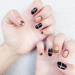 圆形黑色橙色手绘线条美甲图片