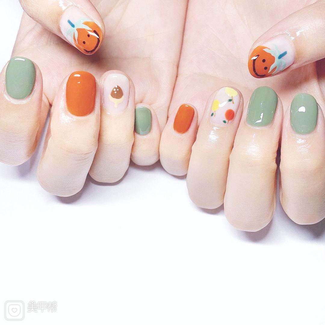 圆形橙色绿色手绘韩式可爱跳色美甲图片