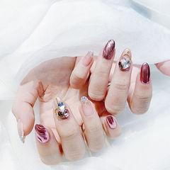 圆形粉色镜面钻水波纹美甲图片