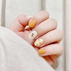 圆形橙色白色手绘水果格纹短指甲全国连锁日式学校学美甲加微信:mjbyxs15美甲图片