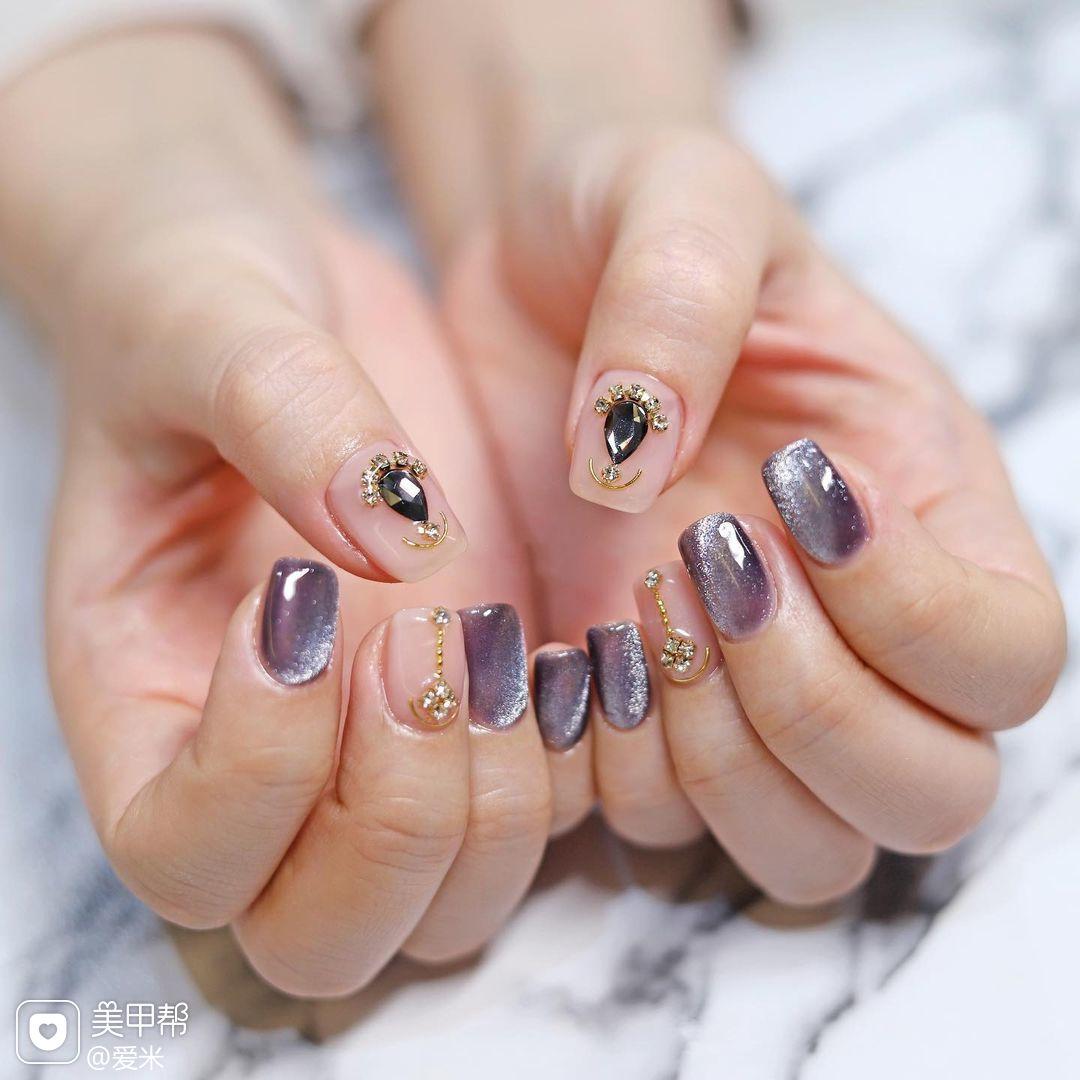 猫眼紫色宝石钻饰美甲图片