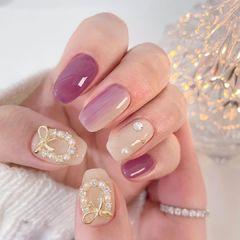 紫色渐变蝴蝶结珍珠裸色美甲图片