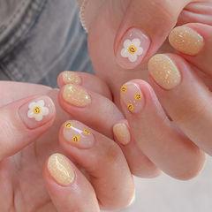 手绘花朵笑脸黄色美甲图片