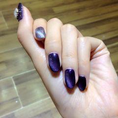 紫圆形猫眼美甲图片