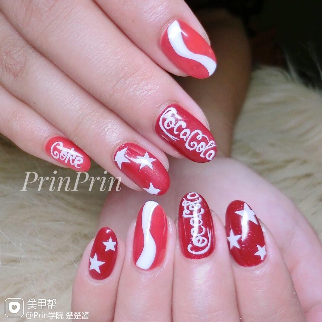 红色手绘星星可乐可乐美甲美甲图片