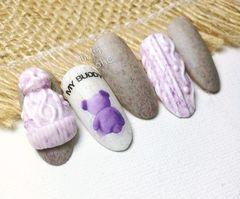 圆形可爱雕花紫色白色毛衣纹美甲图片