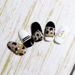 棕色黑色日式简约豹纹手绘白色心形美甲图片