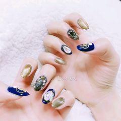 蓝色圆形钻猫眼日式美甲图片