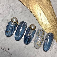 蓝色猫眼珍珠贝壳圆形金箔美甲图片