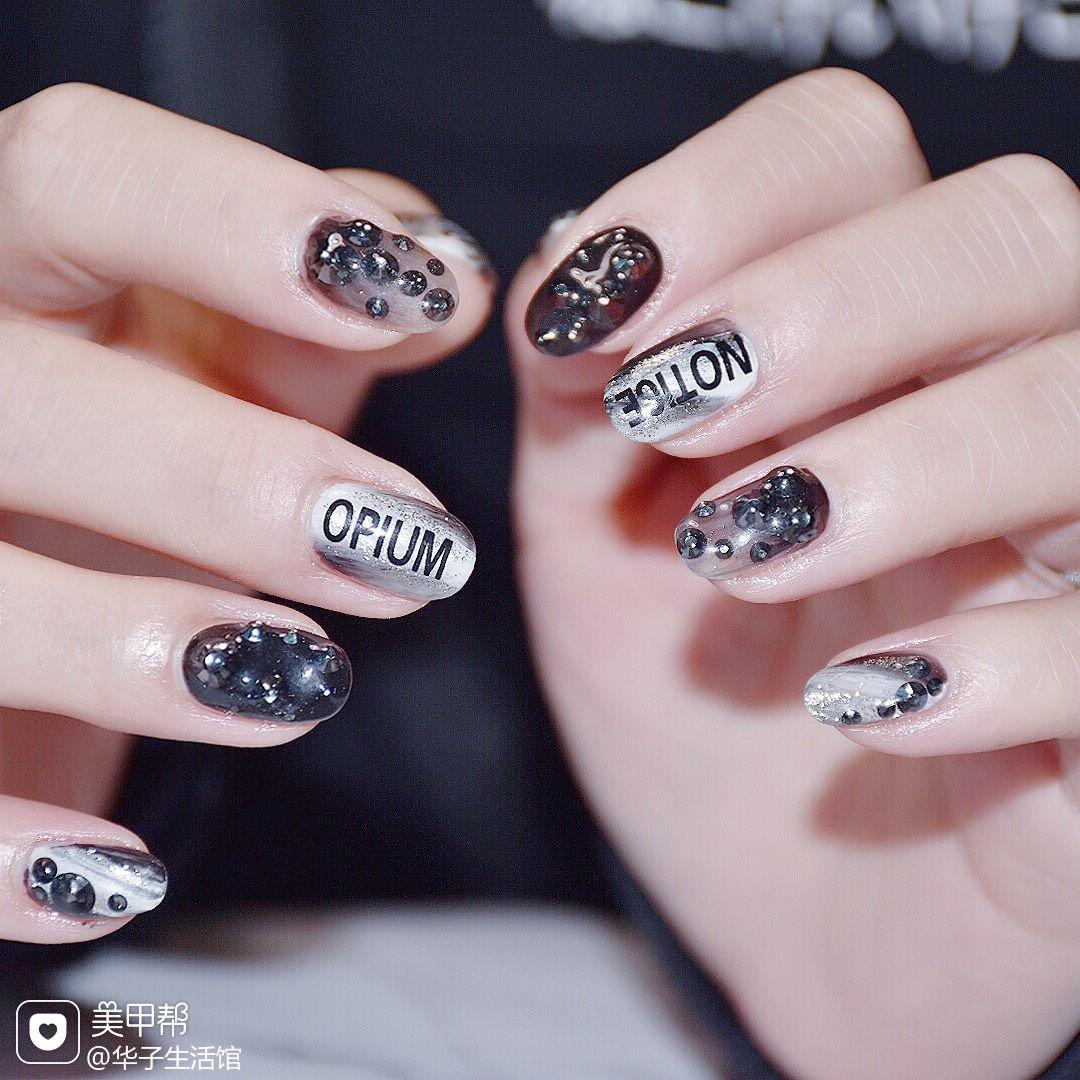 黑色圆形钻日式金属美甲图片