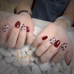 红色尖形豹纹美甲图片