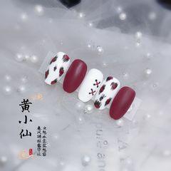 圆形红色白色手绘豹纹丝带磨砂美甲图片