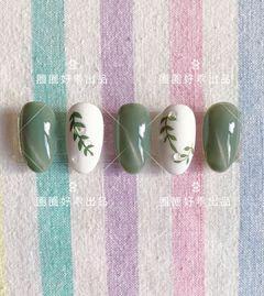 圆形绿色白色手绘树叶猫眼水滴美甲图片