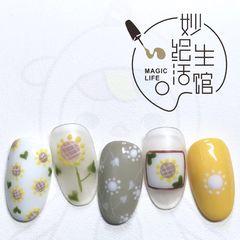黄色圆形春天手绘可爱美甲图片