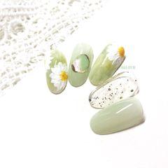 绿色圆形春天花朵手绘美甲图片