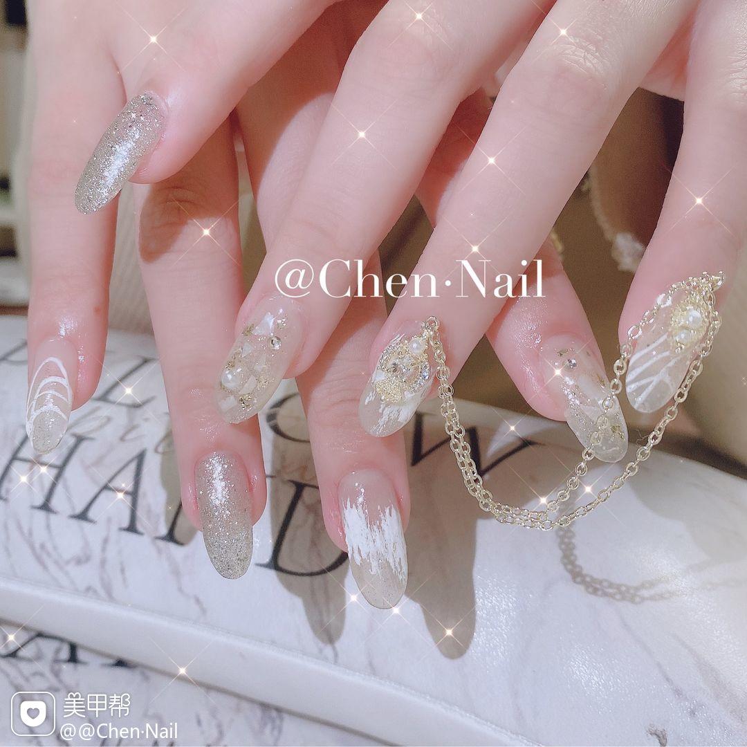 尖形贝壳片金箔新娘美甲图片