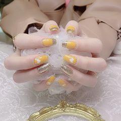黄色金箔美甲图片