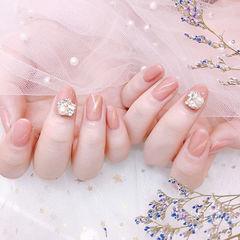 圆形粉色猫眼钻珍珠新娘美甲图片