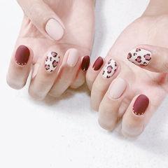 圆形红色粉色白色手绘豹纹磨砂美甲图片
