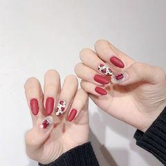 圆形红色白色手绘豹纹钻磨砂美甲图片