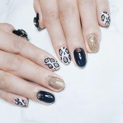 圆形黑色白色金色手绘豹纹美甲图片