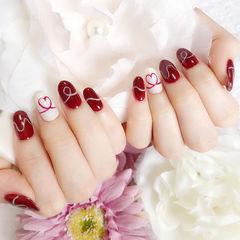 圆形红色白色手绘心形美甲图片