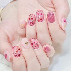 圆形粉色心形亮片美甲图片