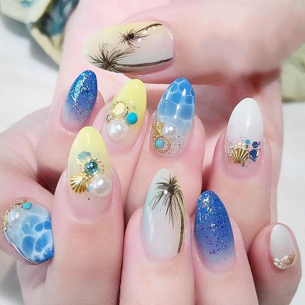 尖形蓝色黄色黑色手绘椰树夏天珍珠想学习这么好看的美甲吗?可以咨询微信mjbyxs6哦~美甲图片