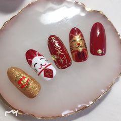 红色圆形金色手绘招财猫新年美甲图片