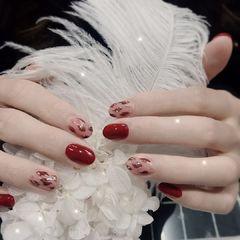 圆形红色手绘豹纹新年美甲图片