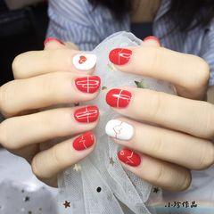 红色圆形手绘美甲图片